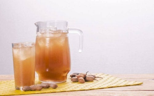 A jug and a glass of tamarind water