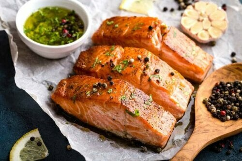 Some cooked salmon with sauces.