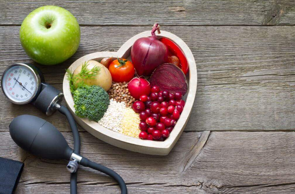 Some healthy foods in a heart shaped bowl, Remedy for High Cholesterol