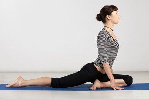 Woman in half pigeon yoga pose