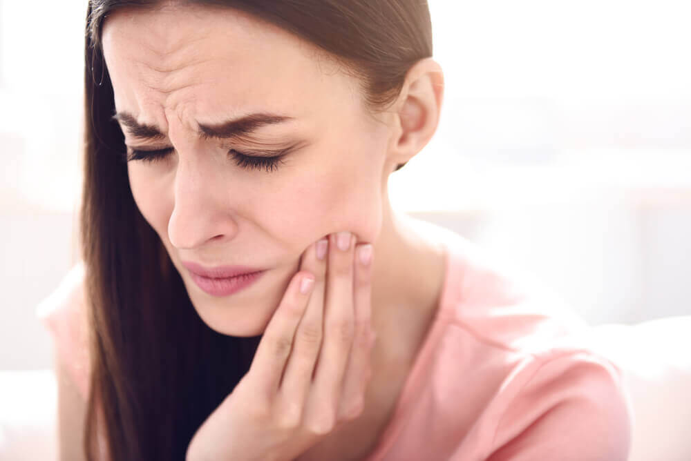 A woman who really wants to get rid of toothache