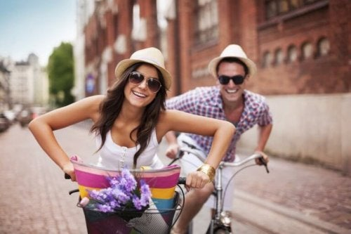 A couple biking together.