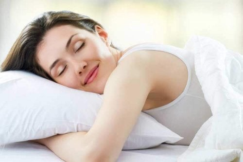 A happy woman sleeping.