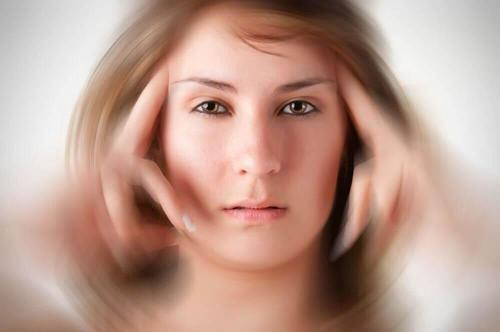 Woman with tunnel vision due to a migraine. Relieve migraines.