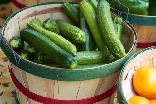 A bucket of courgettes to make a courgette and tomato gratin