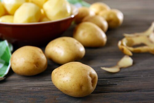 Some raw potatoes in a bowl