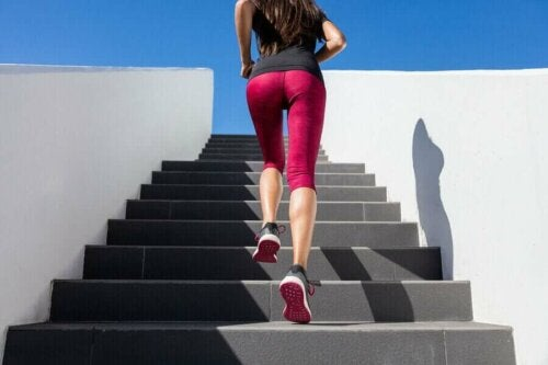 a woman climbing stairs in work out gear