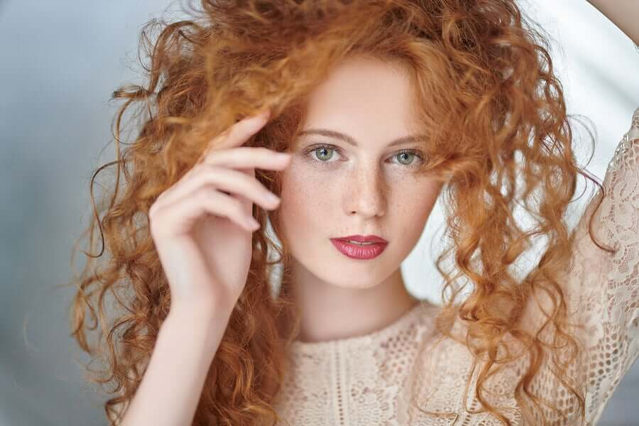 A woman with curly red hair.