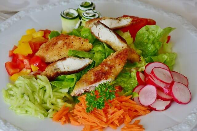 Fresh vegetables and grilled chicken breast.