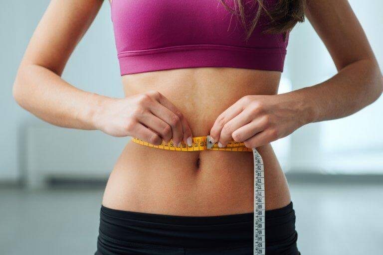 Measuring waistline. Lose abdominal fat.