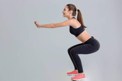 woman squatting from the side
