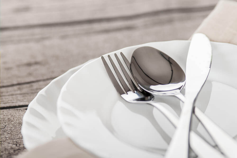 Silverware on a small plate.