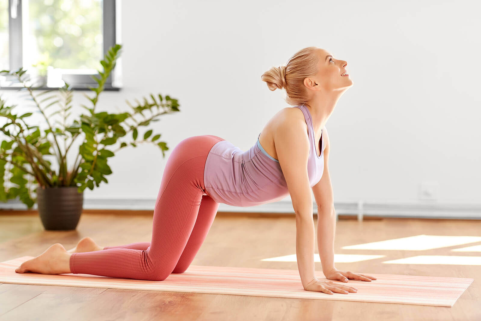 A woman performing a yoga exercise.