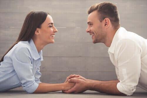 A happy couple talking.