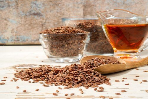 The medicinal flaxseed drink is next to bowls of flaxseed.