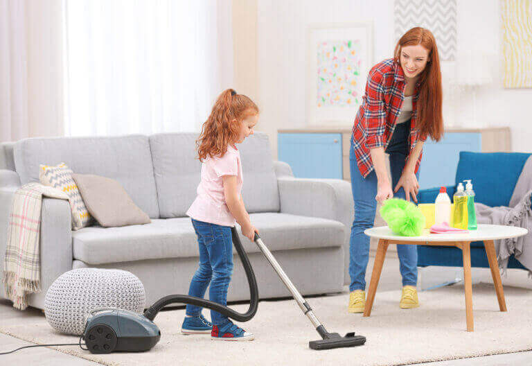 A mother and daughter cleaning the house together.