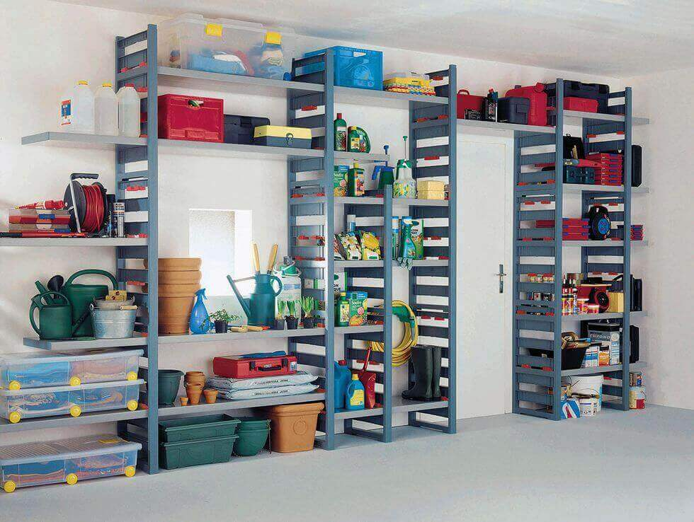 An organized garage with lots of shelves and bins.