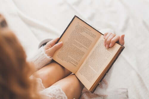 Woman reading in bed.