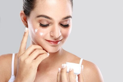 Rejuvenating aloe vera cream on a woman's face