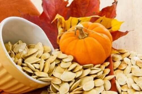 Pumpkin seeds and a small pumpkin.