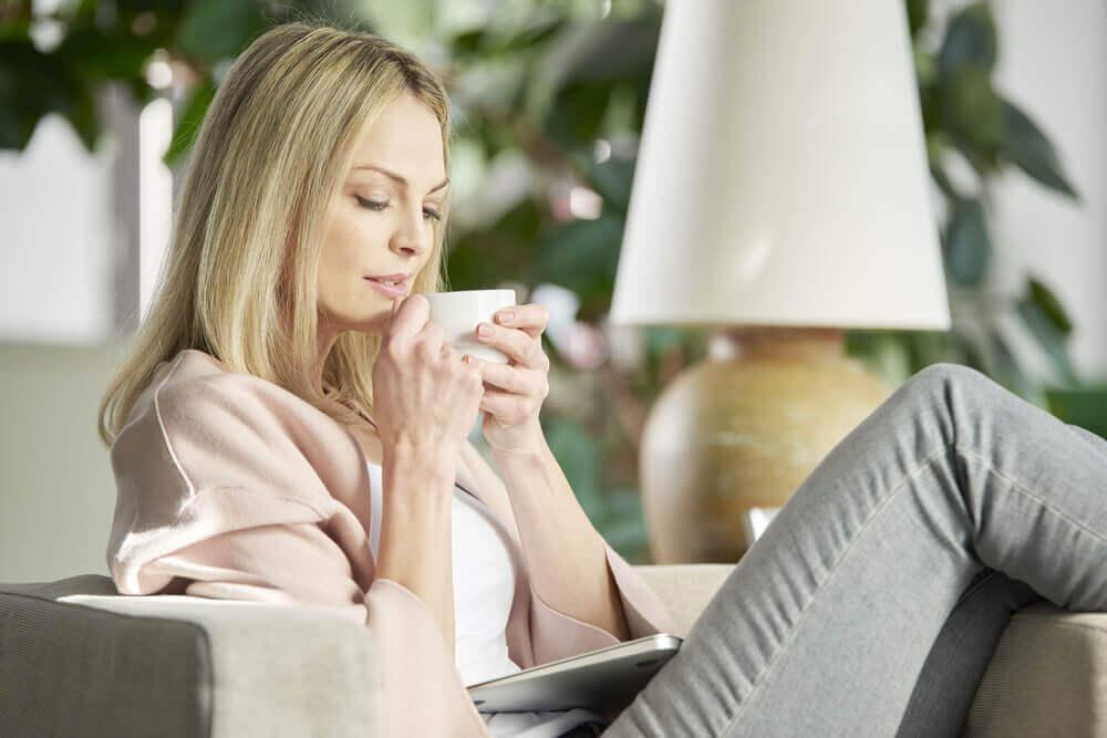 A woman drinking tangerine peel tea.