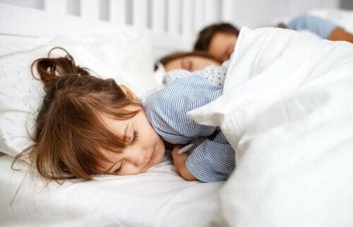 A little girl sleeping.