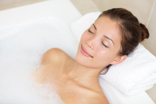 Woman taking a relaxing to get rid of headaches