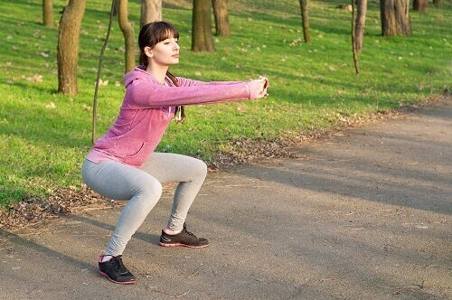 a woman doing squats for firmer buttocks