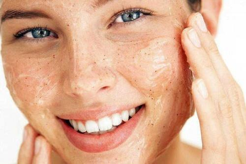 A woman exfoliating for clean and smooth skin.