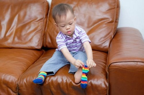Motor skill development: A toddler putting on socks.