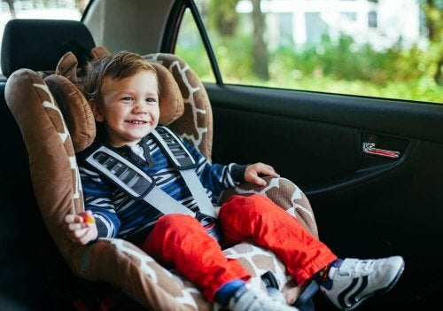 A toddler in a car seat.