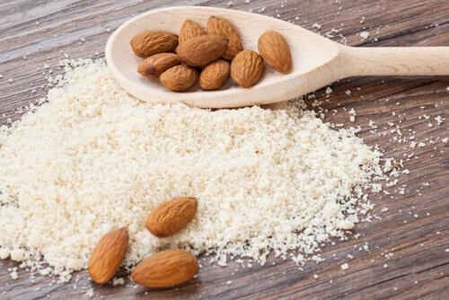 Some almonds and crushed up almonds.