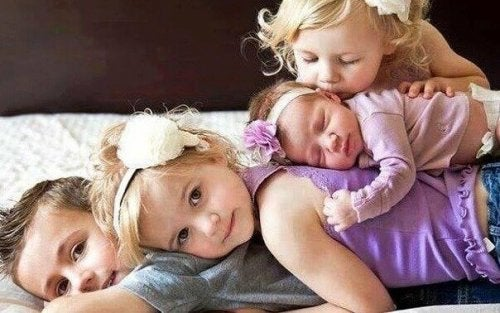 Four children are laying together.