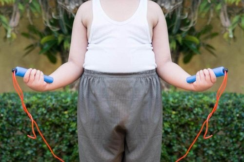 A boy with childhood obesity jumping rope.