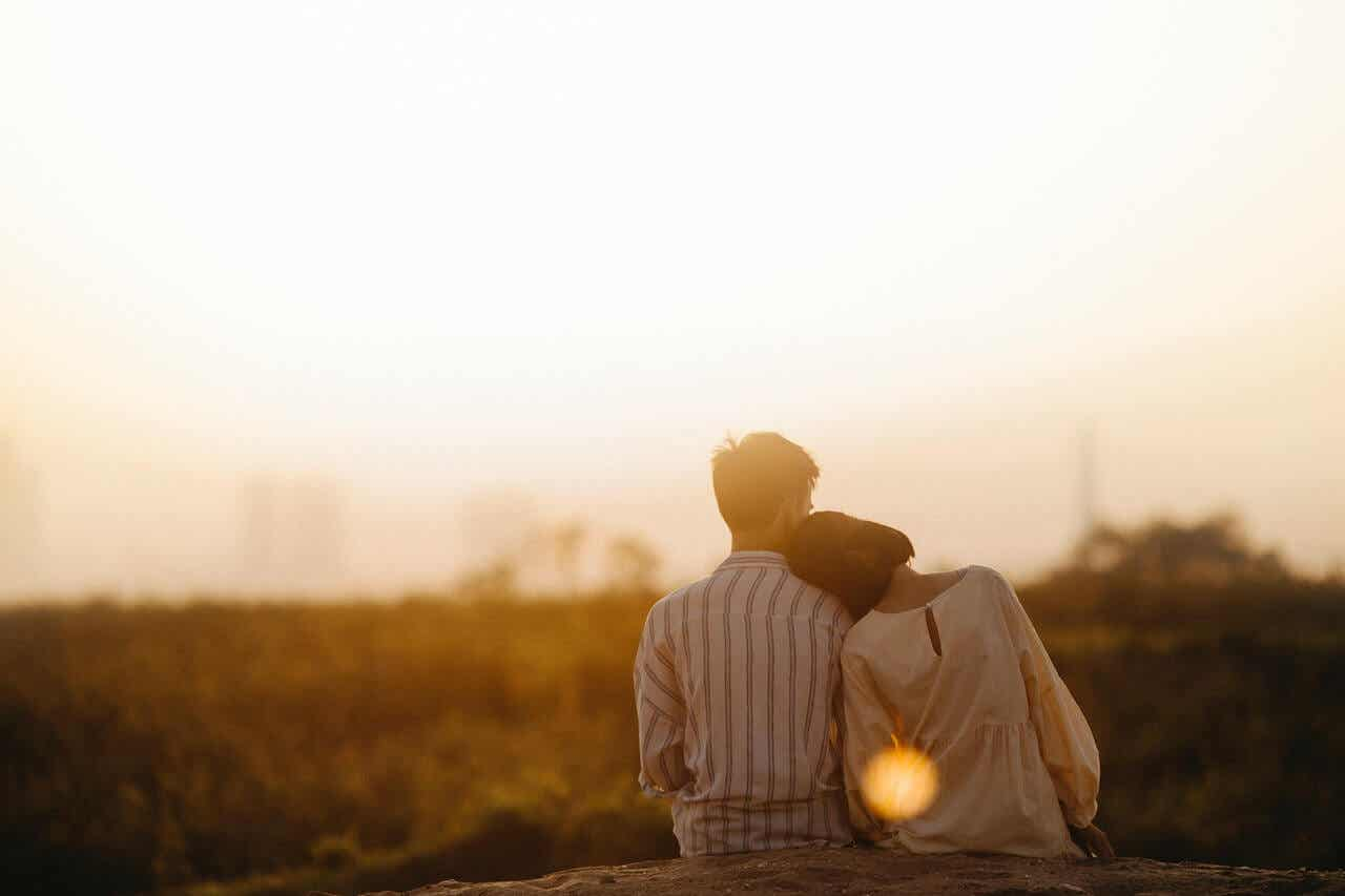 A couple watching a sunset.