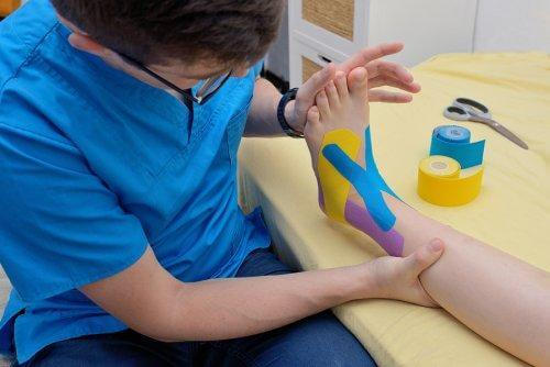 A physiotherapist applying Kinesio Taping.
