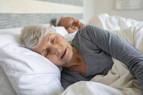 Two seniors sleeping with comfortable clothes.