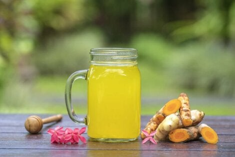 A glass of turmeric drink.