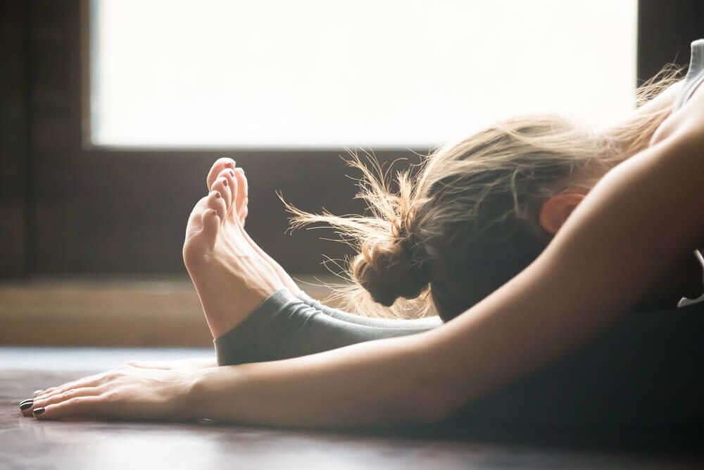 A woman doing a yoga stretch.
