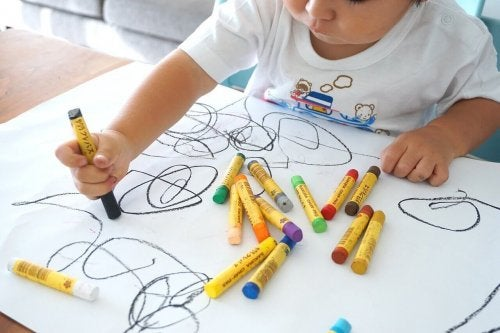 A child drawing with crayons.