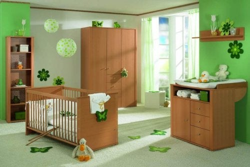 Best colors for a child's bedroom: A nursery decorated with green tones and wooden furniture.