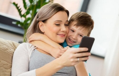 Mom and son using smartphones