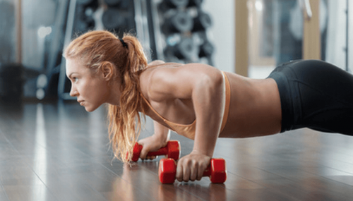 A woman doing push-ups.