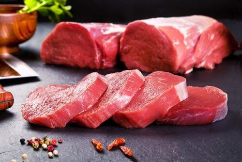 A display of raw veal and steaks.