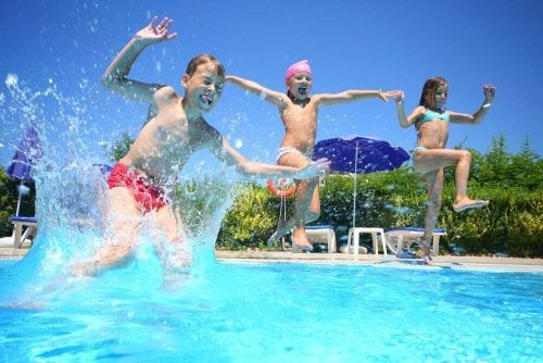 Three children jumping in a pool, they don't seem to be overloaded with activities.