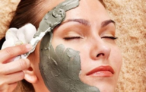 A woman is getting a face mask.