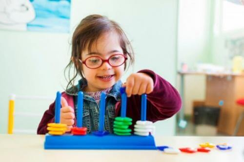 A child with Down syndrome playing.