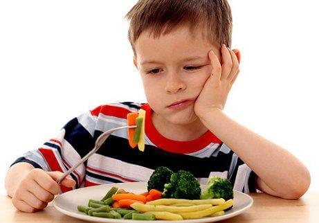 An abused child who doesn't want to eat his vegetables.