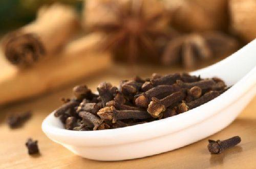 Cloves on a large spoon.