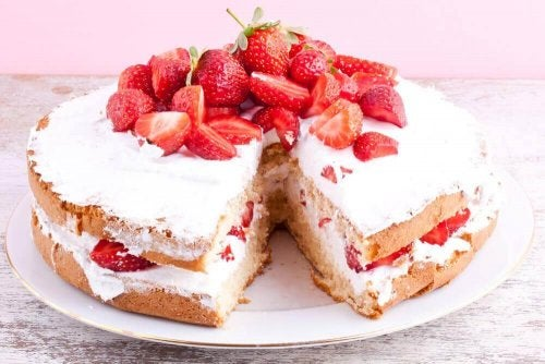 Strawberry cake on a serving dish.